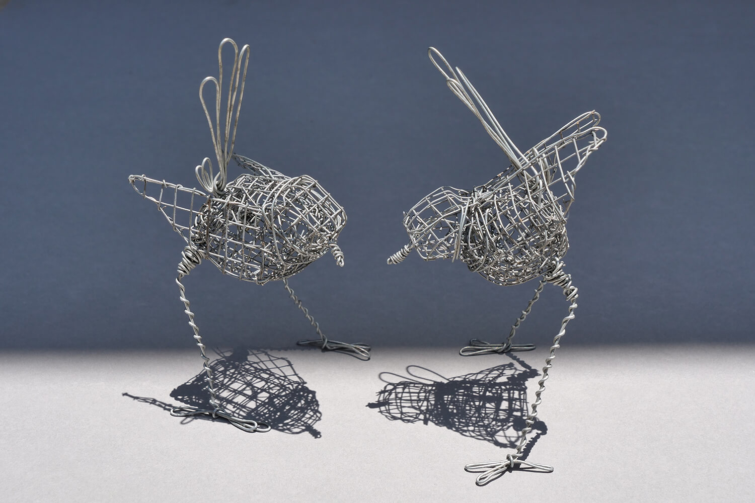 2 Wrens. 2 wire handmade wrens each approximately 13 cm in height x 7 cm wide.