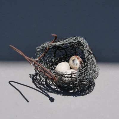 Nest 1. Handmade wire nest approximately 10 cm wide and 9 cm high with polished stone eggs 3 cm. FREE SHIPPING IN AUSTRALIA