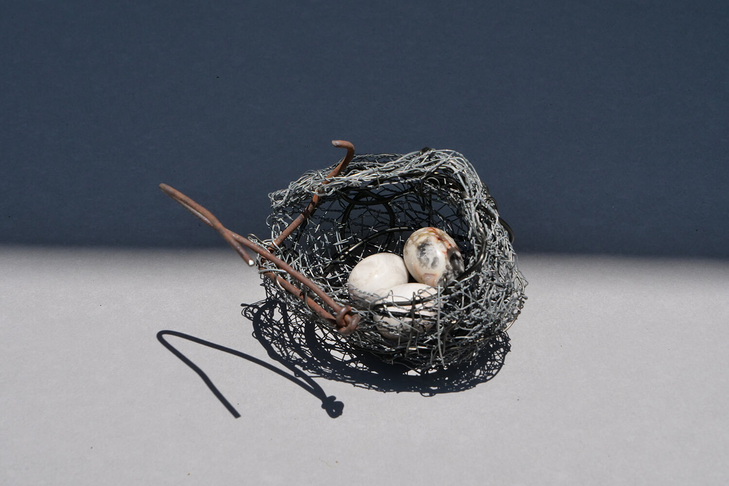 Nest1. Handmade wire nest approximately 10 cm wide and 9 cm high with polished stone eggs 3 cm.