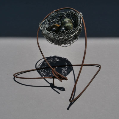 Nest 3. Handmade wire nest approximately 19 cm wide and 10 cm high with polished stone eggs 3 cm. FREE SHIPPING IN AUSTRALIA