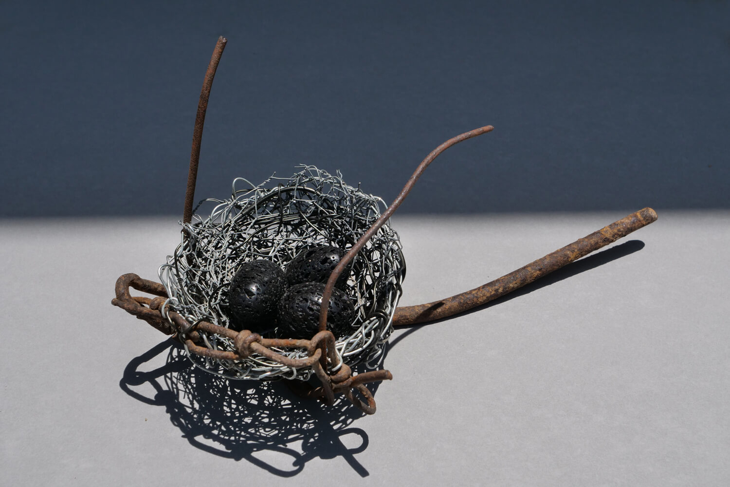 Nest 4. Handmade wire nest approximately 26 cm wide and 10 cm high with polished stone eggs 3 cm. FREE SHIPPING IN AUSTRALIA
