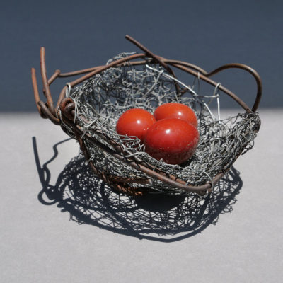 Nest 6. Handmade wire nest 11.5 cm wide and 5.5 cm high with polished stones 3.5 cm.