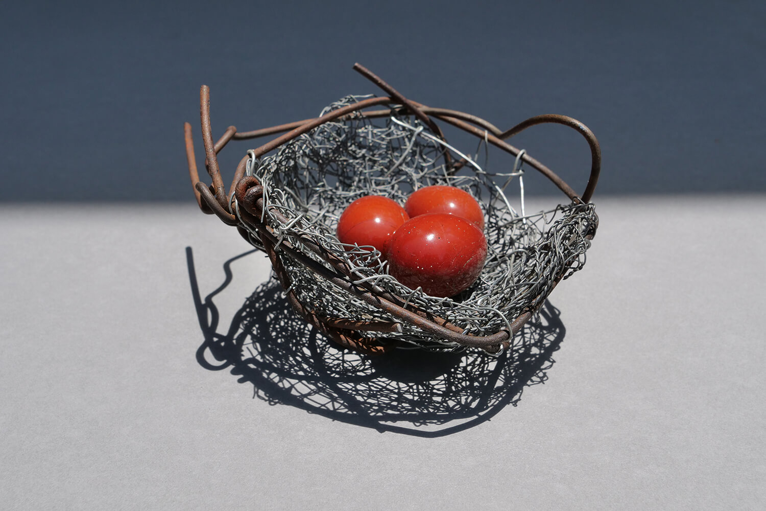 Nest 6. Handmade wire nest 11.5 cm wide and 5.5 cm high with polished stones 3.5 cm. FREE SHIPPING IN AUSTRALIA